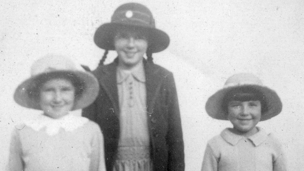 Joan (centre) in her Hampton High school uniform